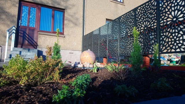 Stone globes in town garden- Papillon Designs & Landscaping